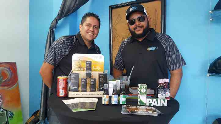Representatives for a CBD company promoting their products in Mayagüez. (Photo courtesy of Vive Boriken and D'Lab)